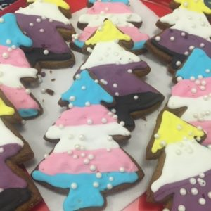 Gingerbread trees with gender identity flags in icing