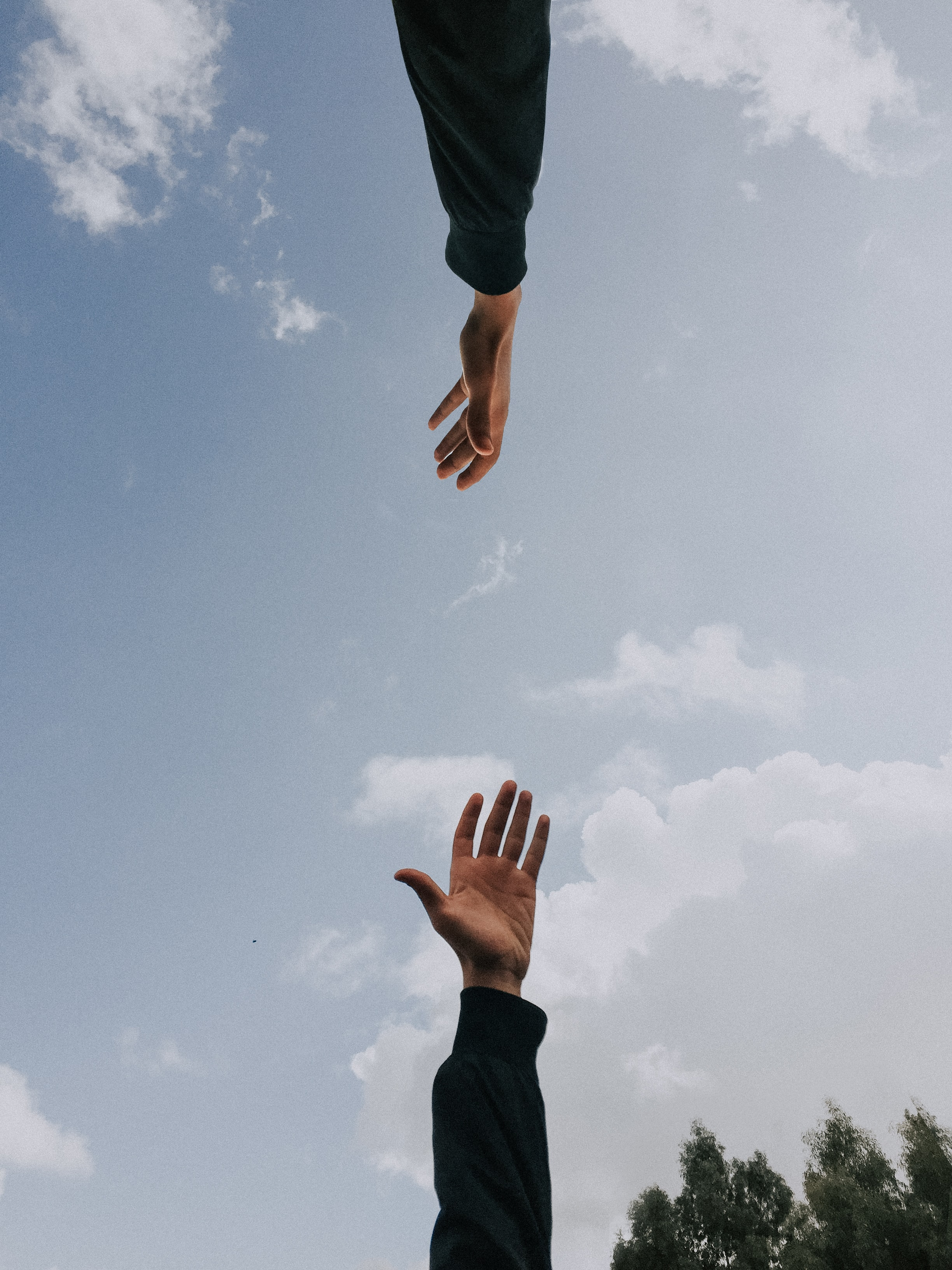 Hands reaching out - building connection