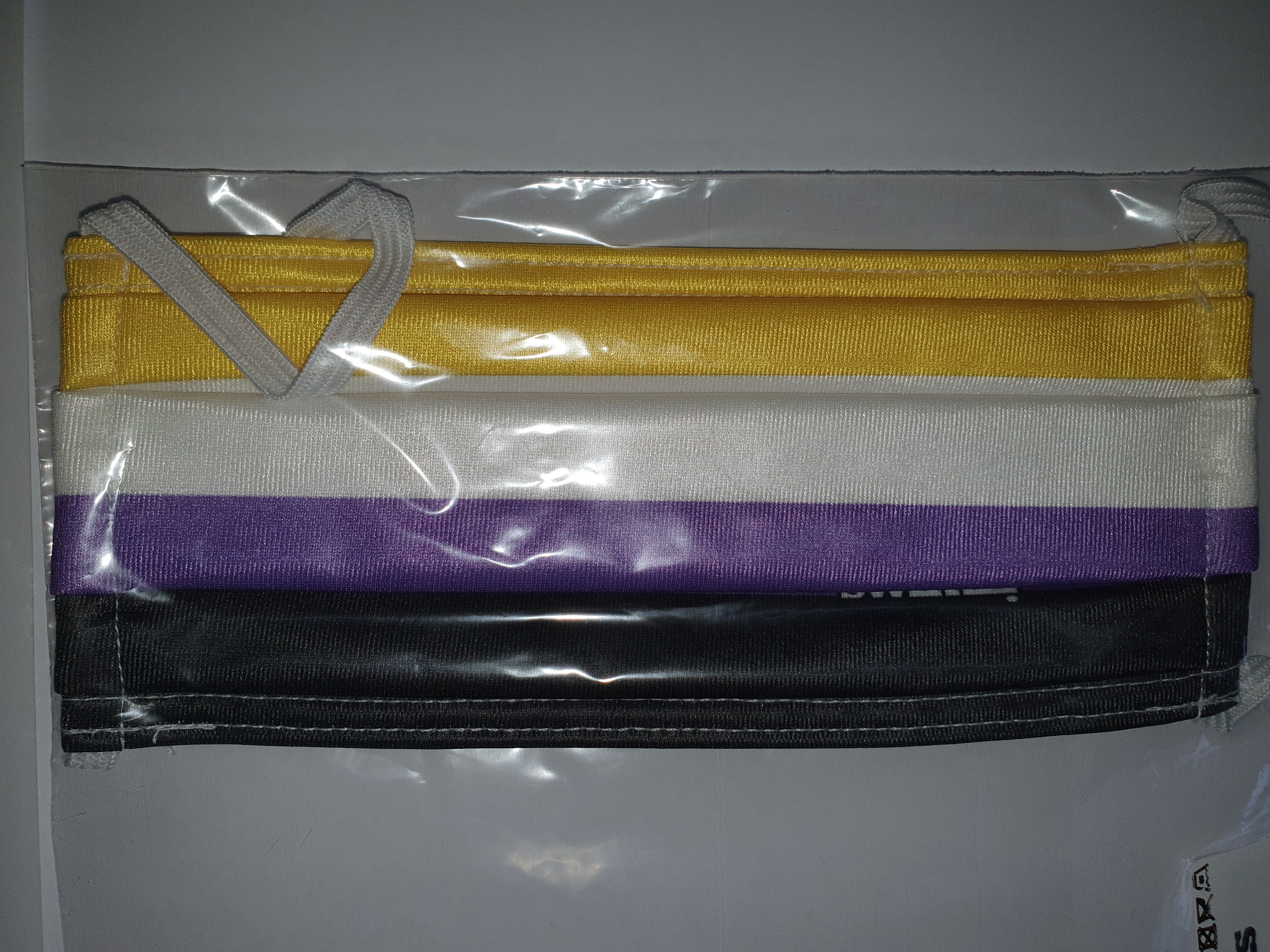 Facemask with yellow, white, purple and black stripe