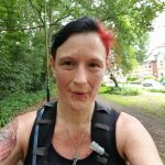 Head and shoulders selfie of Andi in sports gear looking hot and sweaty having completed 6.5 miles running
